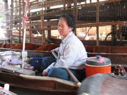 authentic floating market trader selling fast food take-away