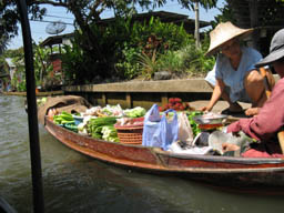 authentic floating market traders doing old fashioned bartering