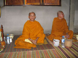 The two monks from our village temple stay after meditation and watch the villagers have their breakfast
