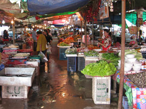 Kut Chap market with the usual bustling trade and beautiful fresh produce